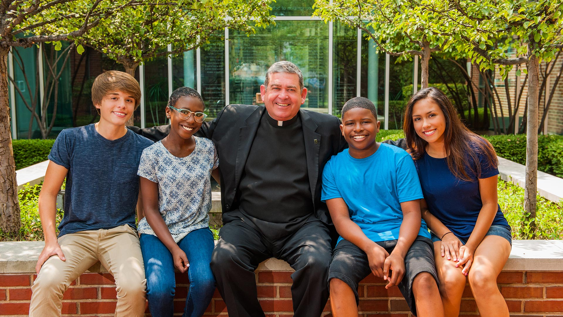 Fr. Scott with Mercy Home young people.