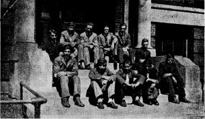 Young men sit on the front steps of Mercy Home.