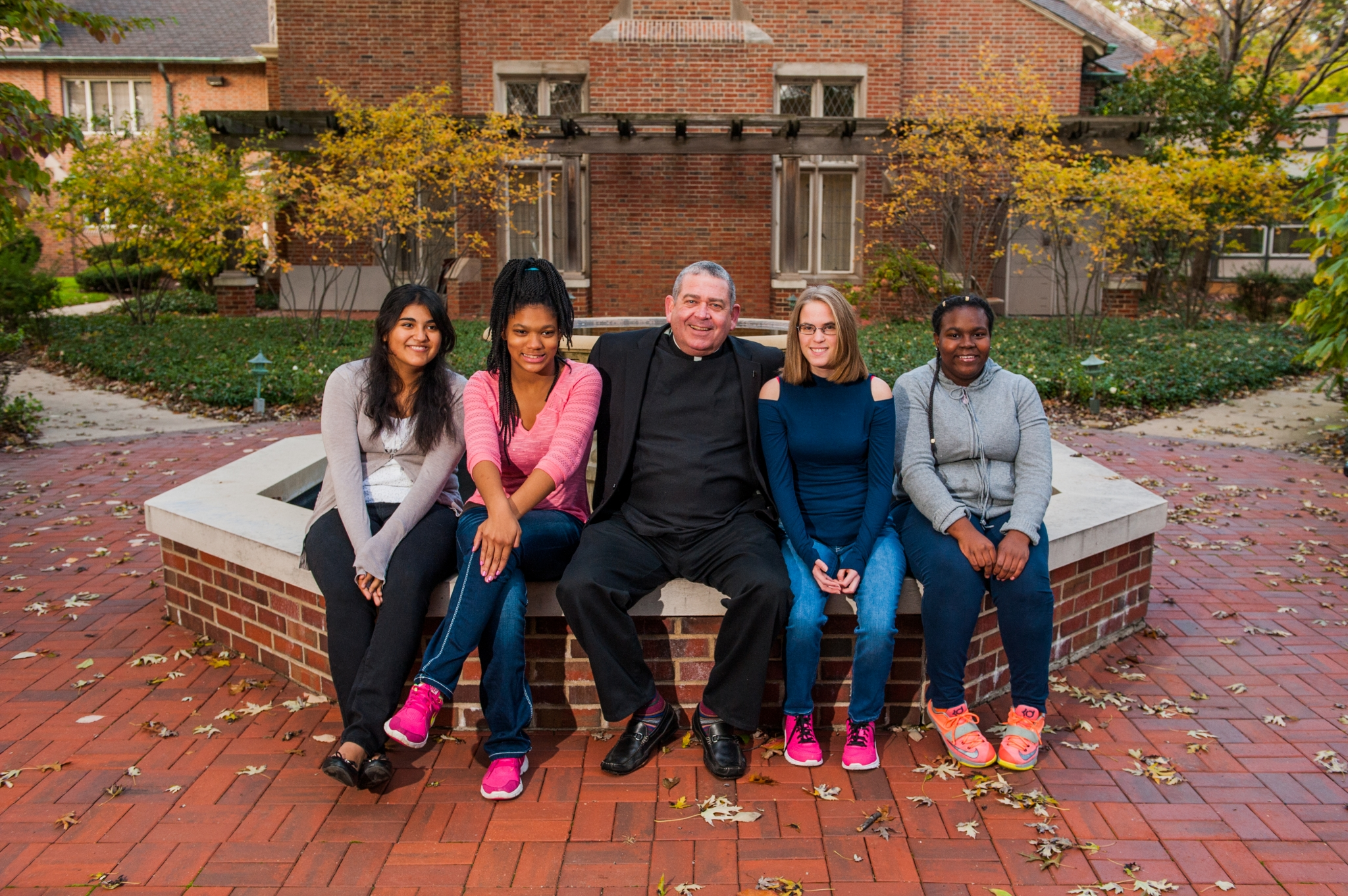 Fr. Scott visits with girls at our Walsh Campus