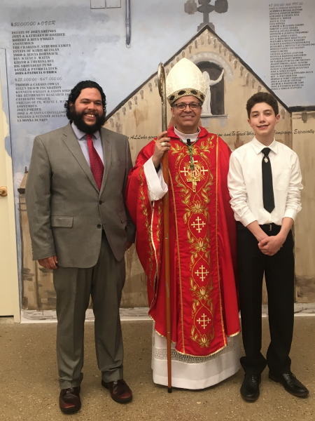 Marc with priest and youth