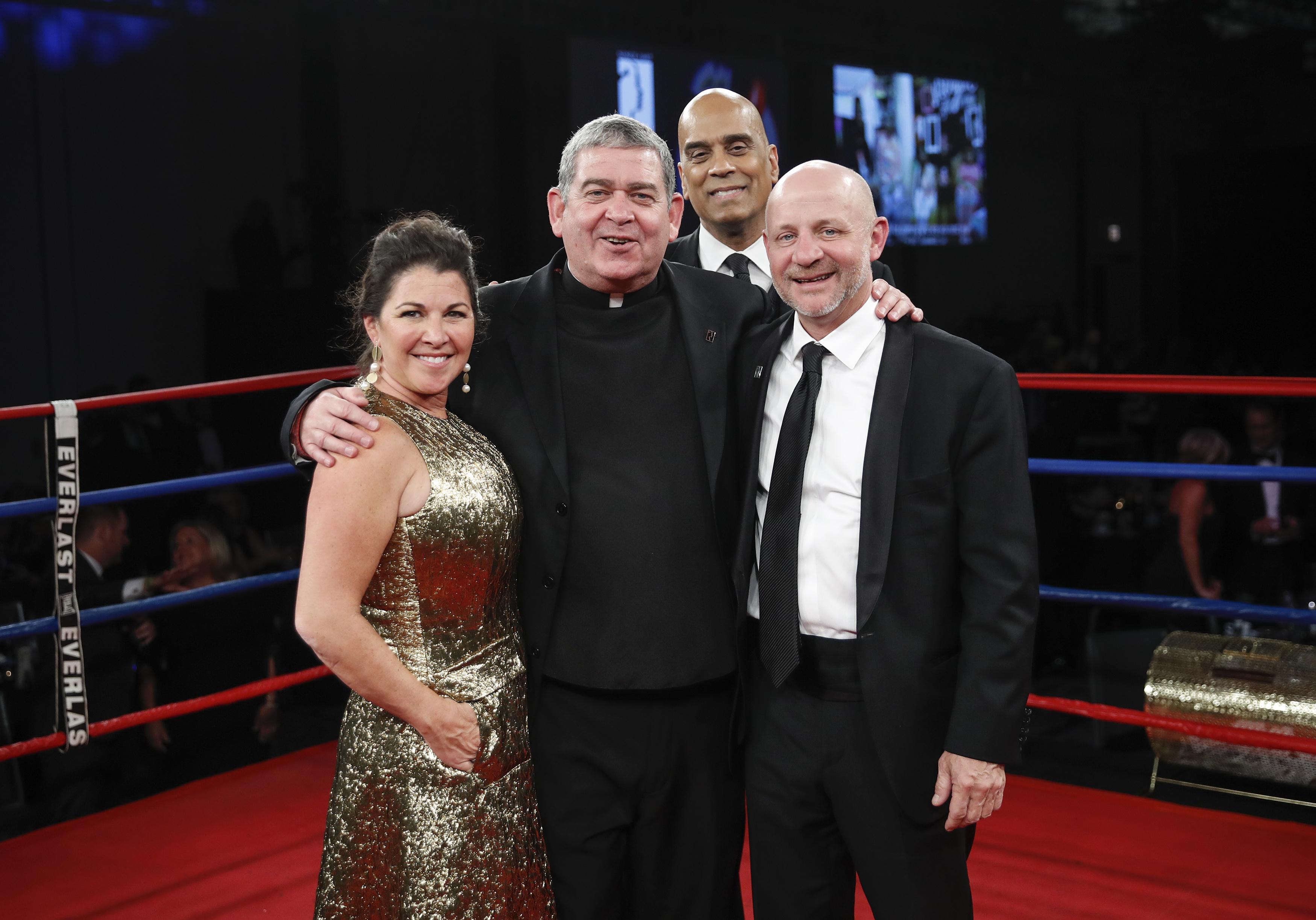 Johanna Rahal, Fr. Scott Donahue, Joe Nolan, and Jim Williams