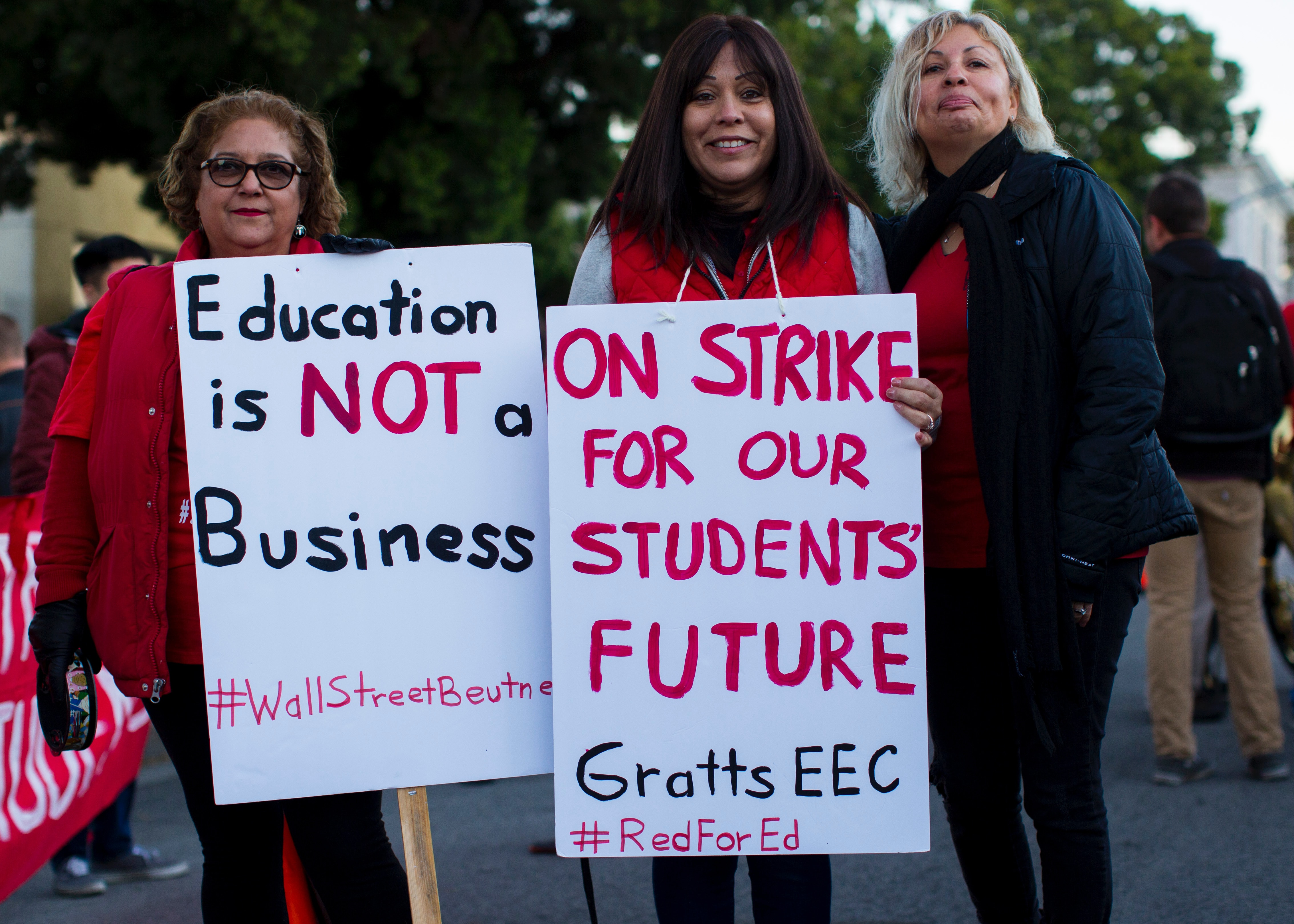 Teacher standing with signs on strike