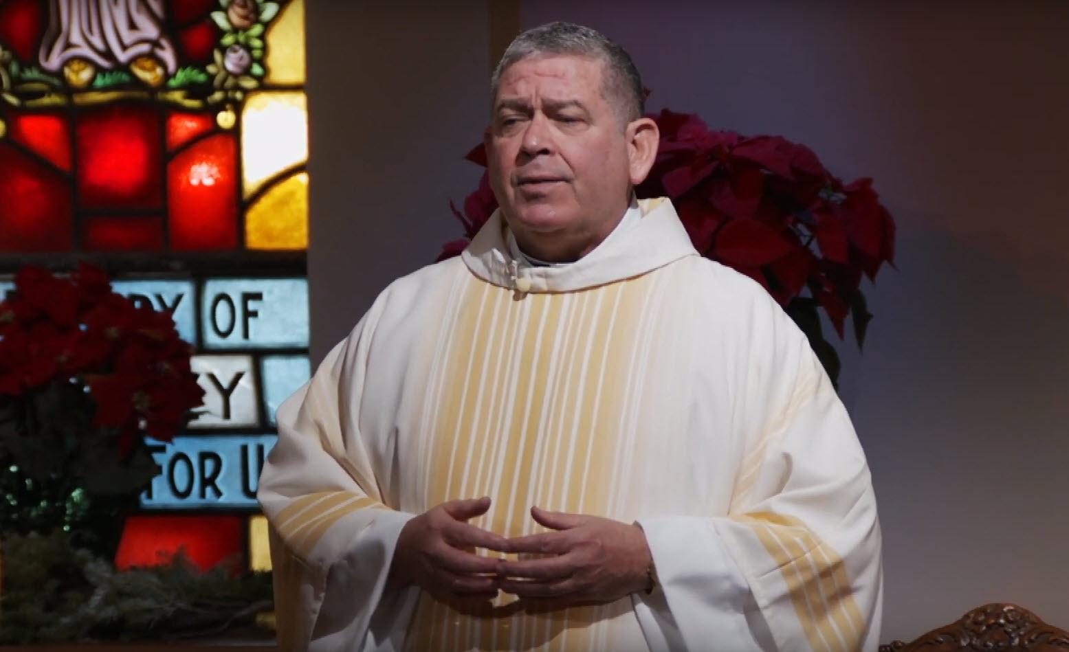 Fr. Scott Donahue leading Christmas Mass