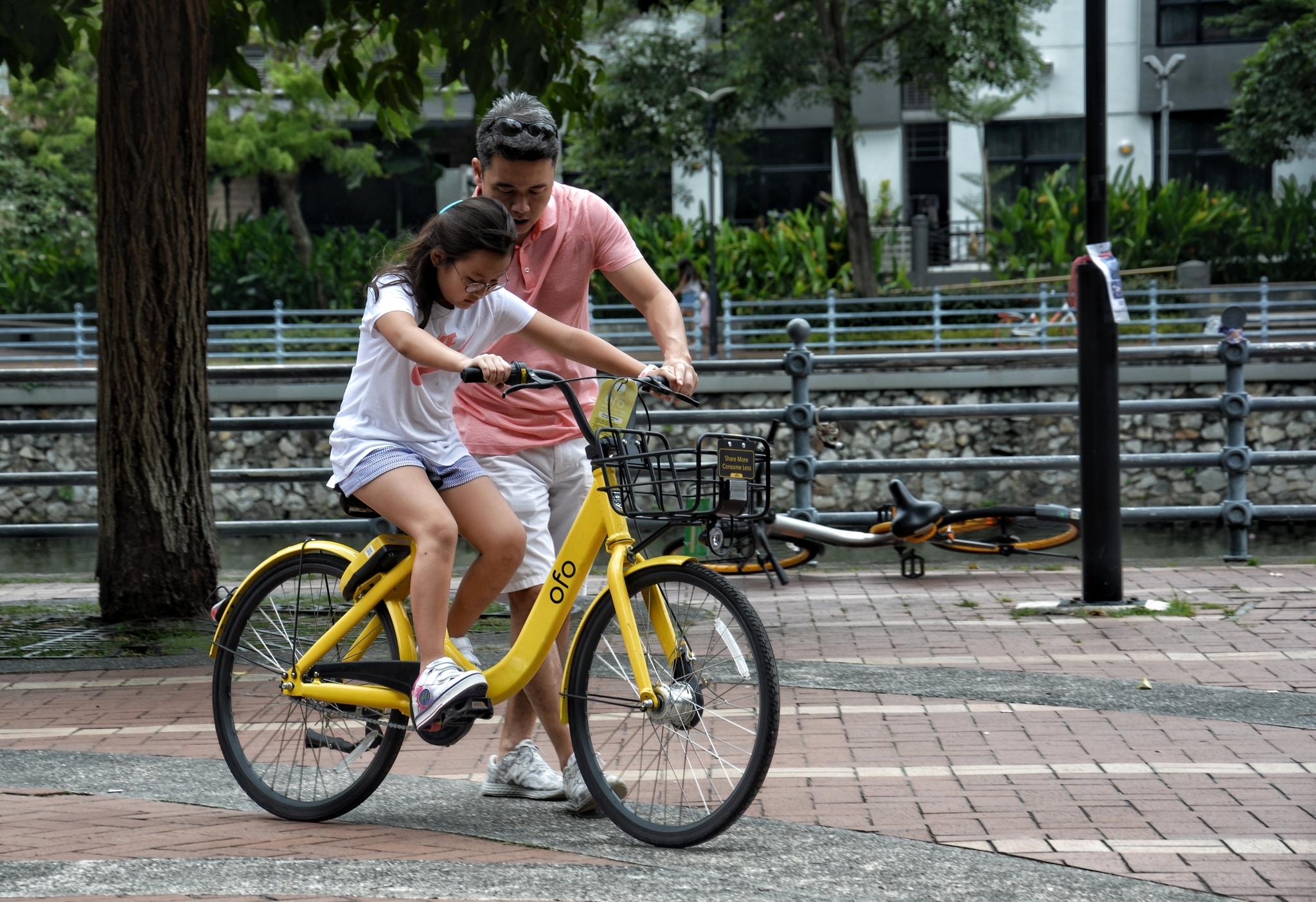 girl riding her bike
