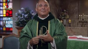 Fr. Jason Malave preaching