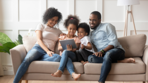 African American family sitting on a couch