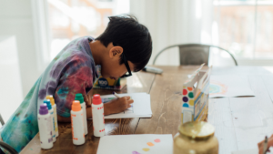 Young boy at a table crafting